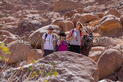 long shot for group of tourists exploring Sinai Mountain for wadi Freij at day.