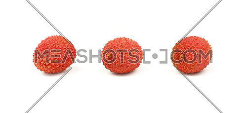 Three fresh red ripe lychee (Litchi chinensis) tropical fruits isolated on white background, detail close up in different perspectives, low angle view