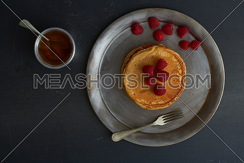 Pan Cakes with red berries and honey top angel