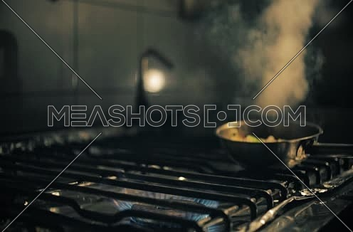 chef cooking pasta in kitchen
