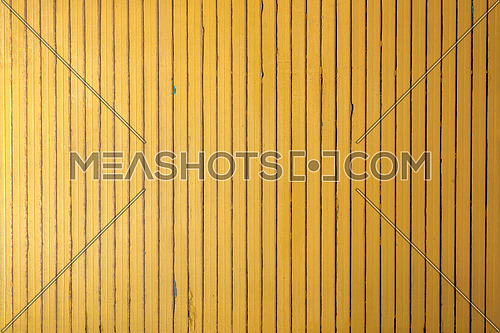 Yellow wooden vertical thin strips wall background