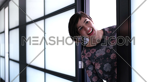 Business having fun and saying hello to someone in front of Office