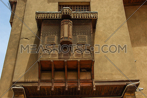 a photo for a historical wooden mashrabeya in old Islamic Cairo , Egypt showing the architecture style used