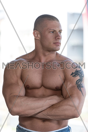 Portrait Of A Physically Fit Young Man Posing In Abondend Ruins