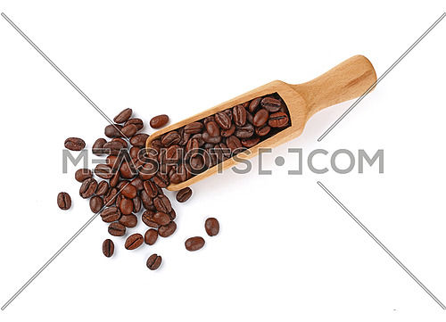 Close up wooden scoop full of roasted Arabica coffee beans isolated on white background, elevated top view, directly above