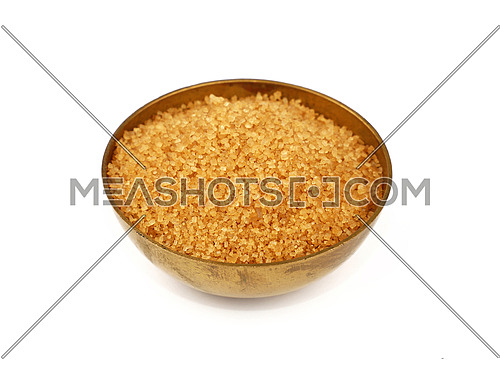 Close up one vintage bronze metal bowl full of raw brown cane sugar, isolated on white background, high angle view
