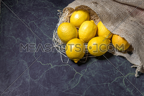 Lemons spilling from a hessian sack