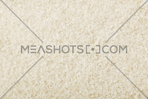 Close up background texture of white sea salt, elevated top view, directly above