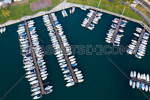 Aerial bird eye view of sailboats and yachts moored in Lovere port, Iseo lake near Bergamo,Italy.