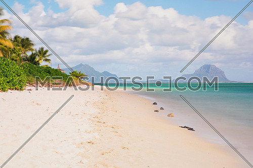 Relaxing on remote Paradise beach,typical tropical beach at Mauritius island.