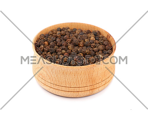 Close up one wooden bowl full of black pepper peppercorns isolated on white background, high angle view