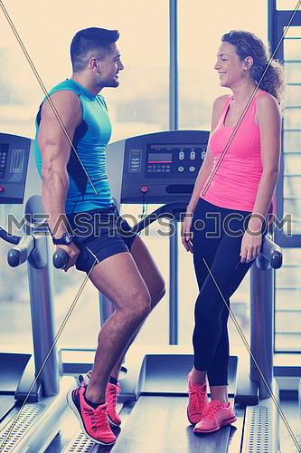 attractive couple at the gym looking happy