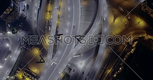 Aerial top shot for 6 of October Bridge over Abd Elmonan Reyad Bus Station At Tahrir Area in cairo at night