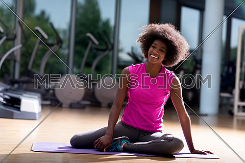beautiful young african american woman exercise yoga in gym