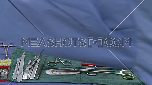 Medium shot for surgical tray with surgical instruments being taken