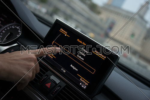 A digital pannel inside a car to control FM radio or mp3 player or cd player
