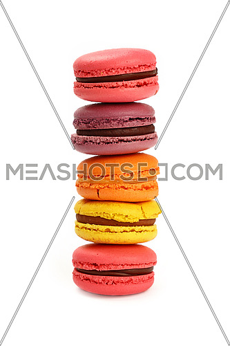 Stack of fresh colorful traditional French macaroon pastry cookies (macarons, macaroni) isolated on white background, close up, low angle view