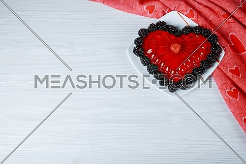 The beautiful jelly hearts on on a dish a white background