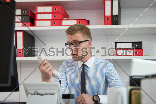 Angry Businessman Yelling Into A Phone