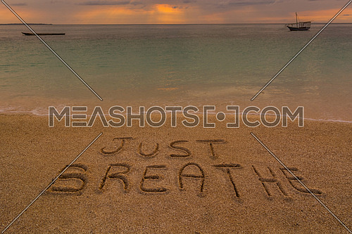 In the picture a beach at sunset with the words on the sand \