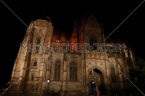 Low angle side view of gothic medieval Cathedral of Saint Elisabeth in Kosice, Slovakia, illuminated in the night
