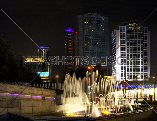 shanghai fountainilluminated by colorfull light by night