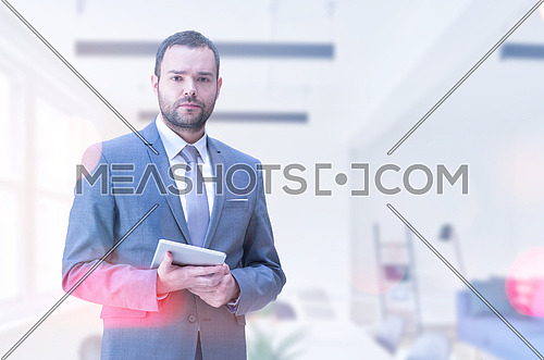 Portrait of senior businessman using tablet in front of his modern office
