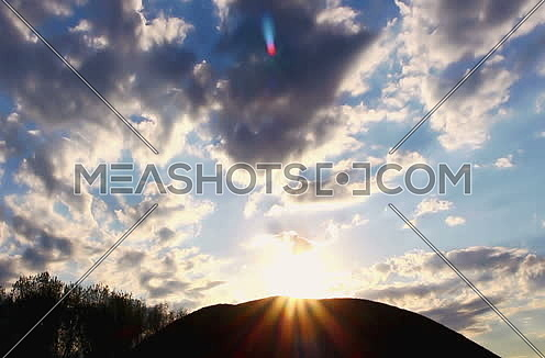 Sun and Clouds Behind The Hill Timelapse