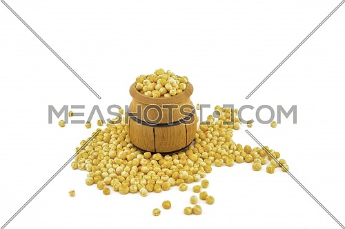 Dried peas spilling from a wooden barrel isolated on a white background