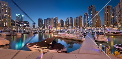 Panoramic View of Dubai Marina Yachts at Sunset with Towers Reflection on Water on september 30 2016