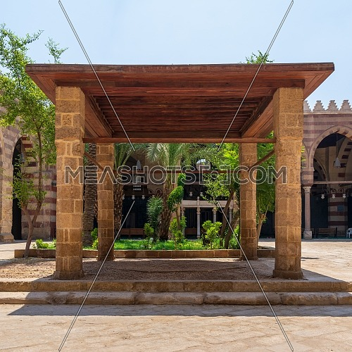 Pergola with four columns and wooden ceiling at courtyard of Amir Aqsunqur Mosque (Blue Mosque), Medieval Cairo, Egypt