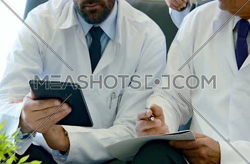 close up middle eastern doctors meeting and discussing with team