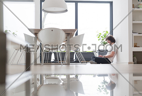 Real man Using laptop on the floor At Home  Enjoying Relaxing