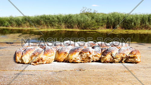 Strudel on a Wooden Table Resting All Sprinkeld With sugar Powder