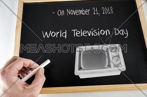 On November 21, 2018 world day of the television written to hand with chalk on a slate, conceptual image