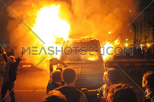 Demonstrators set fire to a central security vehicle in Tahrir Square - Cairo on 28 January 2013