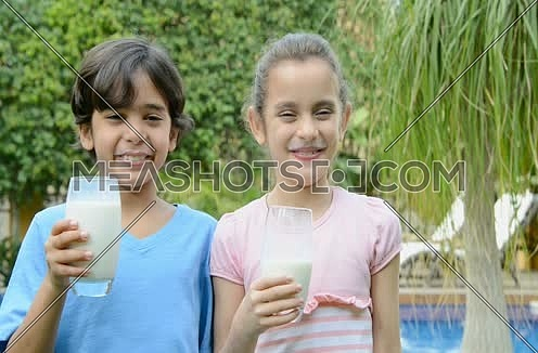 a boy and girl smiling after drinking milk