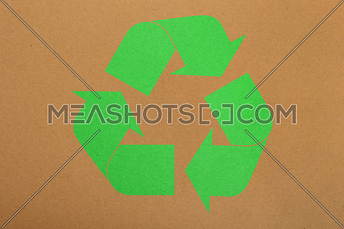 Natural brown design craft paper parchment background texture  with green recycling logo icon