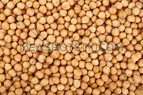 Dried chickpea beans close up pattern background, elevated top view