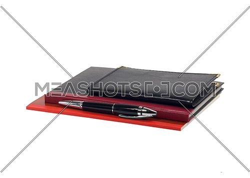 assorted notebooks and fountain pen isolated on white background
