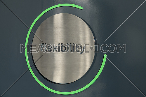 Engraving a CNC machine on a piece of metal. Engraving flexibility text. High quality photo