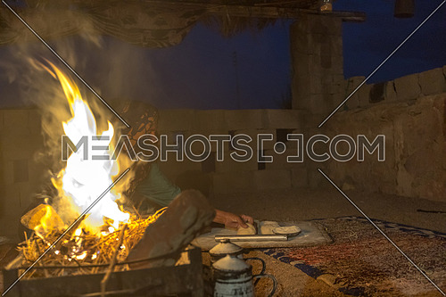 Bedouin Females cooking traditional food at a shelter in Sinai by Night
