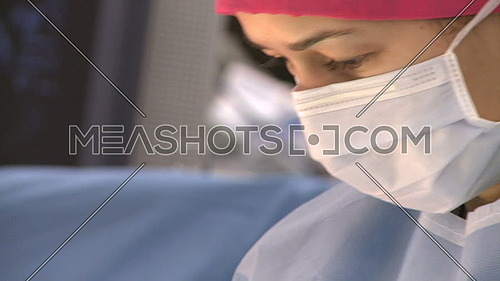 Close up shot for a nurse face in operation room