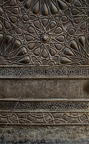 Ornaments of the bronze-plate door of Sultan al-Zahir Barquq Mosque, Muizz Street, Old Cairo, Egypt
