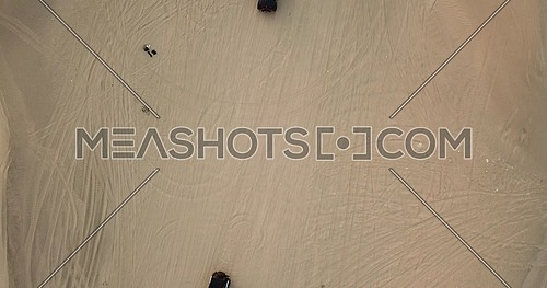 Drone Top shot for trucks off roading in the desert at day