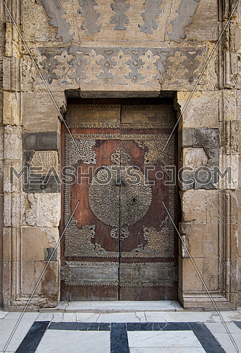 One of the doors surrounding the main yard of Al-Sultan Al-Zahir Barquq mosque. Al-Moez Street, Old Cairo, Egypt