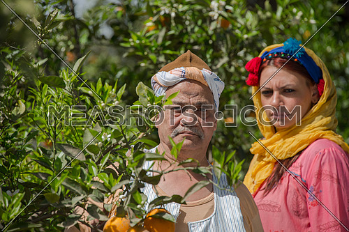 an egyptian farmer and his daughter posing in the farm