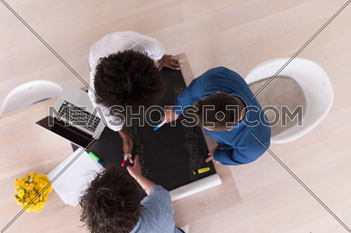 Multiethnic startup business team on meeting in modern bright office interior brainstorming, top view