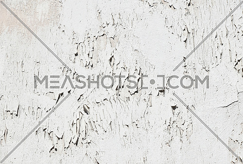 Vintage flakes of old faded white paint over abandoned grey concrete wall
