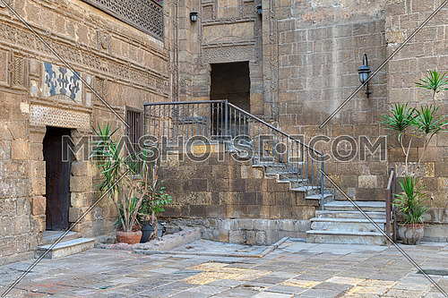 Courtyard of Prince Taz palace with staircase and entrance leading to the first floor located in Old Cairo, Egypt